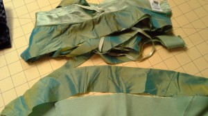 I started with a 100% silk green long skirt I got out of a free box in Talkeetna, Alaska. FYI curved strips suck to work with! But the material was breathtaking!